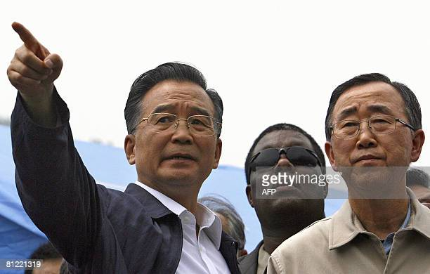 Chinese Premier Wen Jiabao points out a collapsed building to UN Secretary General Ban Kimoon as they visit the earthquakehit town of Yingxiu in...