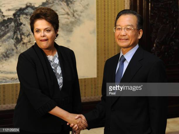 Chinese premier Wen Jiabao shakes hands with Brazilian President Dilma Vana Rousseff on April 13 2011in Beijing China The Brazilian President is on a...