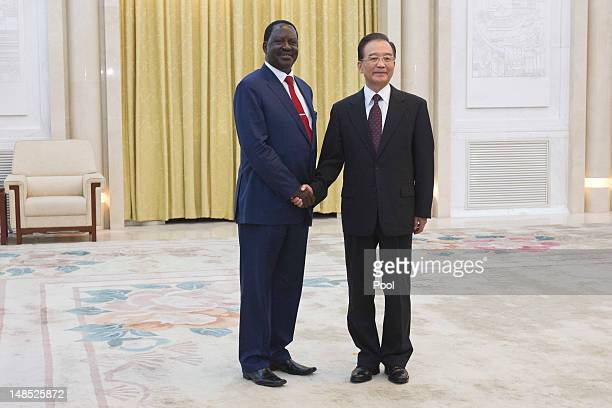 Chinese Premier Wen Jiabao shakes hands with Kenyan Prime Minister Raila Odinga during their meeting at the Great Hall of the People July 18 2012 in...