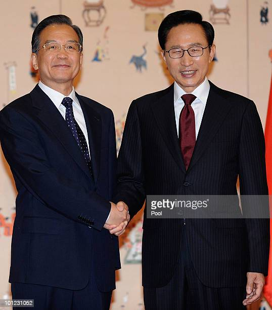 Chinese Premier Wen Jiabao shakes hands with South Korean president Lee MyungBak prior to their meeting at Presidentical House on May 28 2010 in...