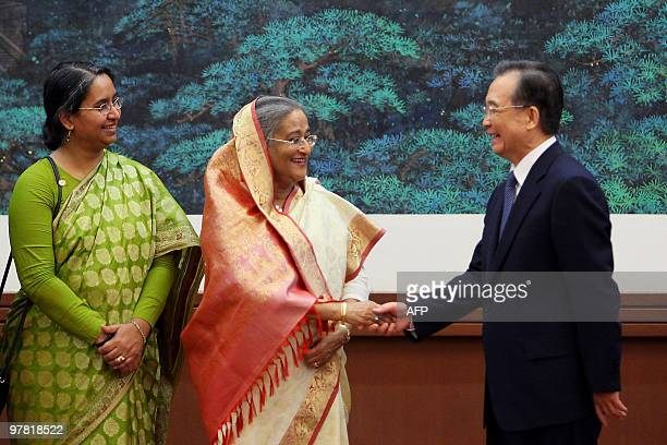 Chinese Premier Wen Jiabao shakes hands with the Prime Minister of Bangladesh, Sheikh Hasina Wajed after a signing ceremony in the Great Hall of the...