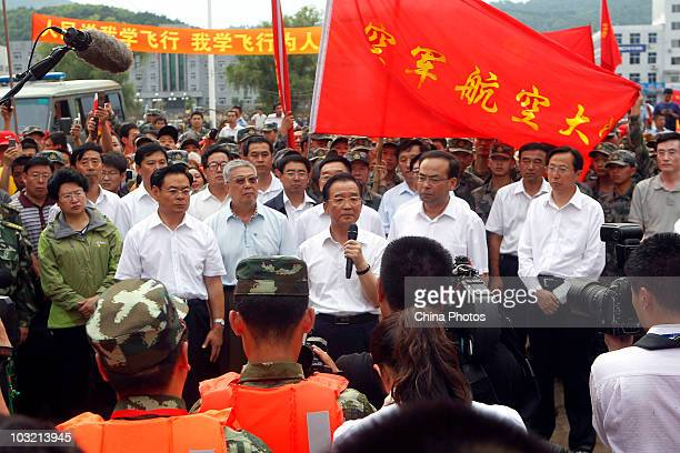 Chinese Premier Wen Jiabao speaks to local residents during his visit to floodhit Yongji County on August 3 2010 in Kouqian Jilin Province China...