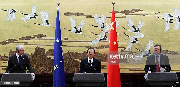 Chinese Premier Wen Jiabao speaks to reporters as European Commission President Jose Manuel Barroso and European Council President Herman Van Rompuy...