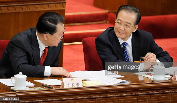 Chinese Premier Wen Jiabao talks with Li Changchun the party propaganda chief during the second plenary session of of the National People's...
