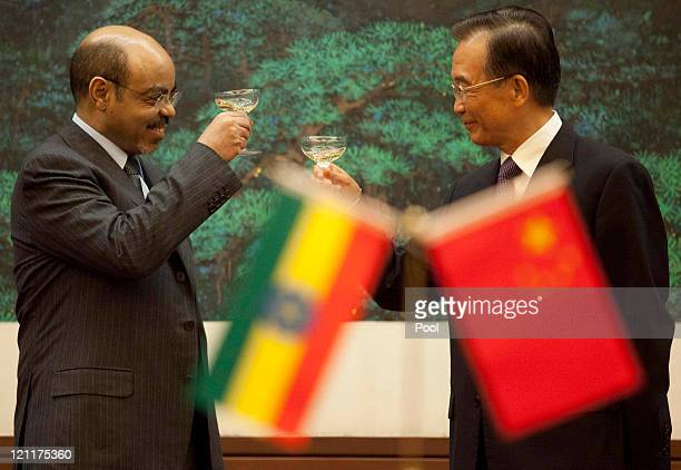 Chinese Premier Wen Jiabao toasts with Ethiopian Prime Minister Meles Zenawi at the Great Hall of the People meet on August 15 2011 in Beijing China...