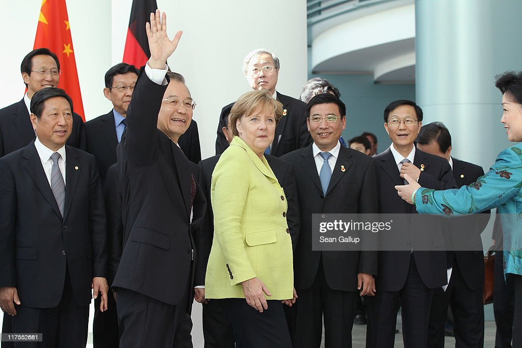 Chinese Premier Wen Jiabao waves as he, German Chancellor Angela Merkel and government ministers of both countries depart after posing for a group photo at the Chancellery on June 28, 2011 in Berlin, Germany. The Chinese leader is visiting a variety of European countries and in Germany is participating in the first-ever German-Chinese government consultaitons.
