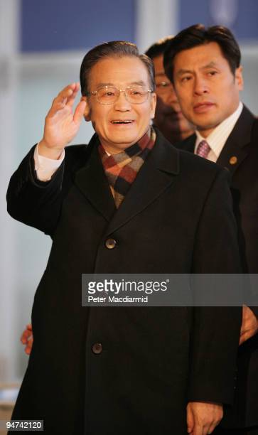 Chinese Premier Wen Jiabao waves to reporters as he arrives for the final day of the UN Climate Change Conference on December 18 2009 in Copenhagen...