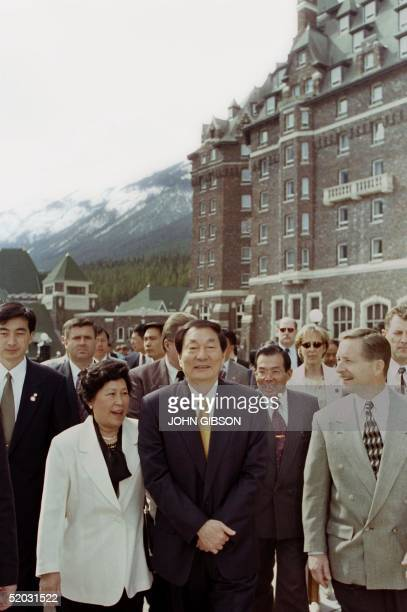 Chinese Premier Zhu Rongji and his wife Lao An are pictured with Ted Kisane manager of the Banff Springs Hotel during a tour of the facility 18 April...