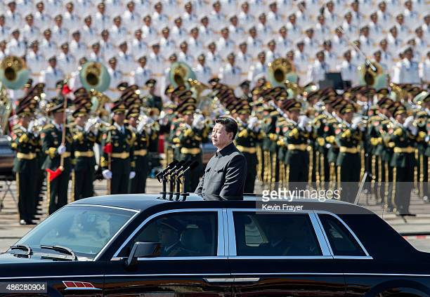 Chinese president and leader of the Communist Party Xi Jinping rides in an open top car in front of Tiananmen Square and the Forbidden City during a...