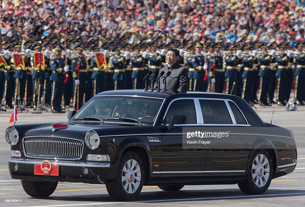 Chinese president and leader of the Communist Party Xi Jinping rides in an open top car in front of Tiananmen Square and the Forbidden City during a military parade on September 3, 2015 in Beijing, China. China is marking the 70th anniversary of the end of World War II and its role in defeating Japan with a new national holiday and a military parade in Beijing.