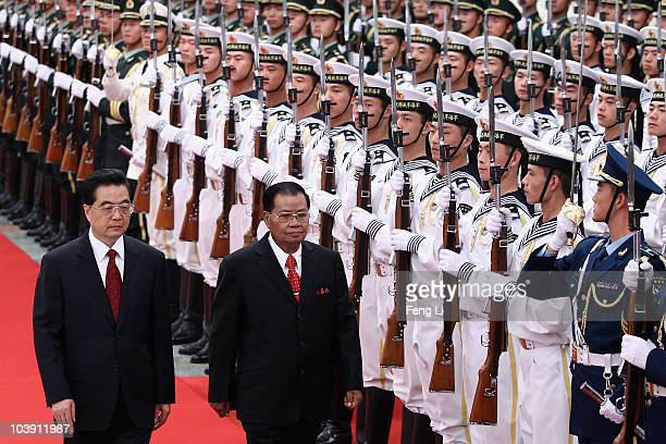 Chinese President Hu Jintao accompanies Myanmar's military junta leader Gen. Than Shwe reviews an honour guard during a welcoming ceremony inside the...