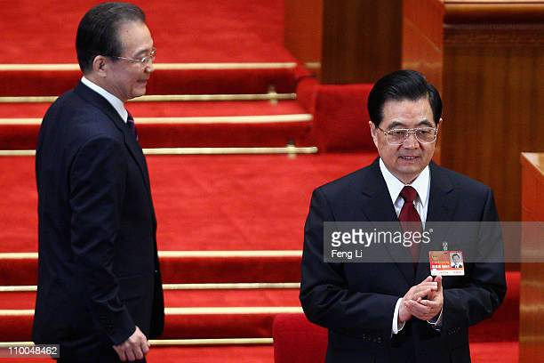 Chinese President Hu Jintao and China's Premier Wen Jiabao attend the closing of the National People's Congress at the Great Hall of the People on...