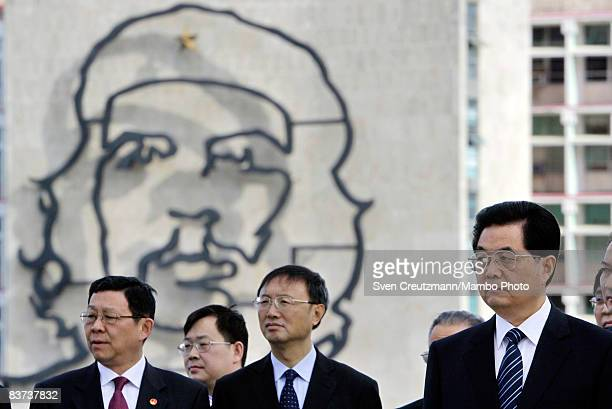 Chinese President Hu Jintao and Chinese officials watch a wreath laying ceremony at the Jose Marti monument on the Plaza de la Revolucion November 18...