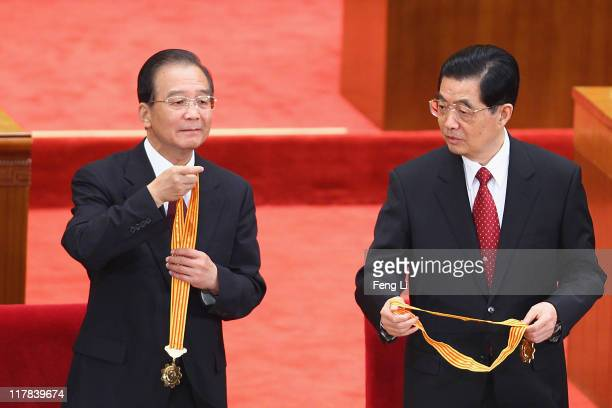 Chinese President Hu Jintao and Chinese Premier Wen Jiabao award medals for the outstanding Communists during the celebration of the Communist...