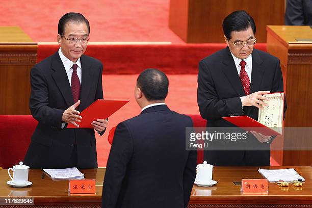 Chinese President Hu Jintao and Chinese Premier Wen Jiabao award the certificate to the outstanding Communists during the celebration of the...