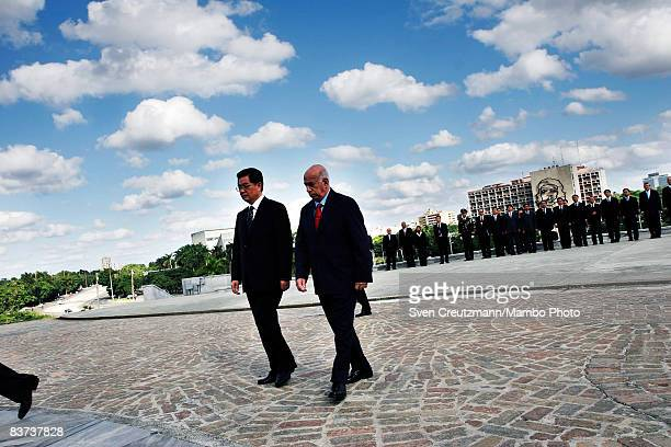 Chinese President Hu Jintao and Cuba´s Vice President Jose Ramon Machado Ventura walk during a wreath laying ceremony at the Jose Marti monument on...