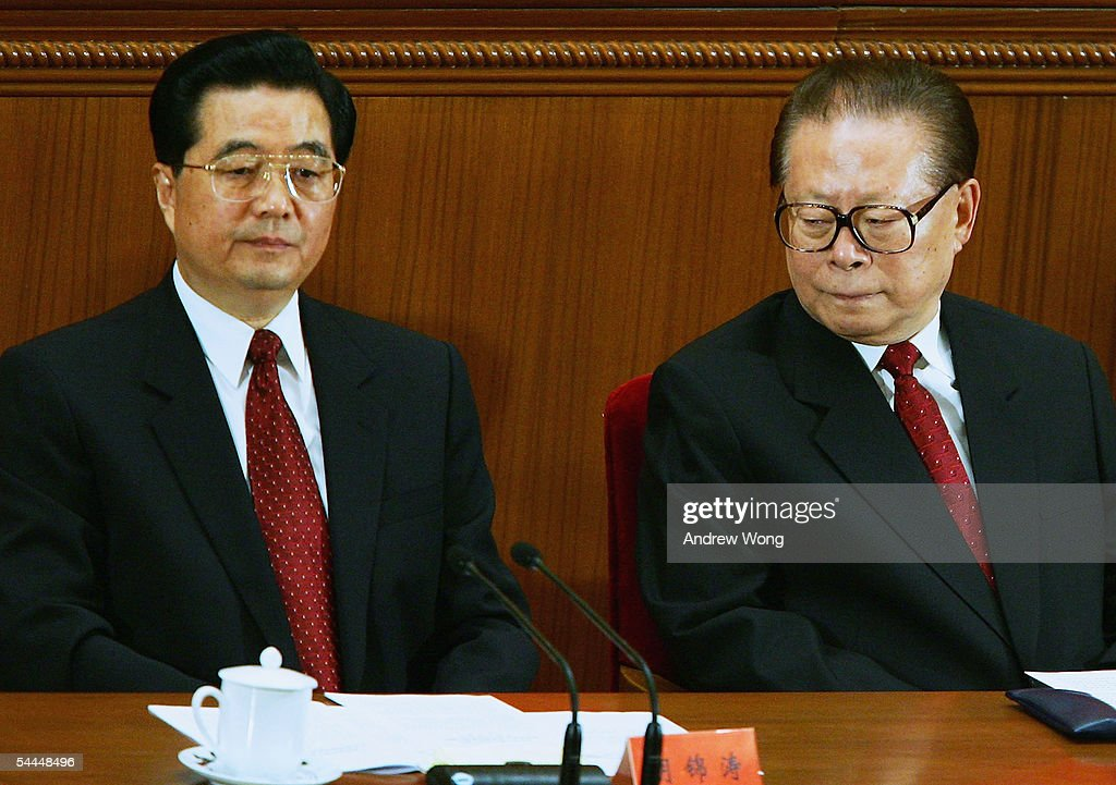Chinese President, Hu Jintao, (L) and former President, Jiang Zemin, attend a meeting marking the 60th anniversary of the victory of China's Resistance War Against Japanese Aggression September 3, 2005 in Beijing, China.