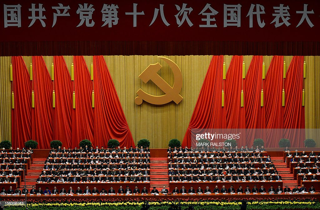 Chinese President Hu Jintao (Centre L) and former president Jiang Zemin (Centre R) sit with members of the Presidium during the closing ceremony of the Party Congress at the Great Hall of the People in Beijing on November 14, 2012. China's Communist Party will on November 15 unveil the new set of top leaders who will run the country for the next decade, one day after its week-long congress ends. AFP PHOTO/Mark RALSTON