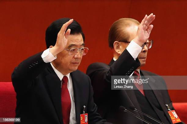 Chinese President Hu Jintao and former president Jiang Zemin vote at the closing of the 18th Communist Party Congress at the Great Hall of the People...