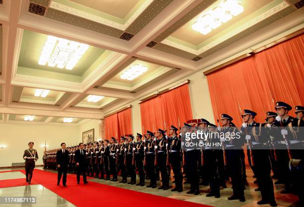 Chinese President Hu Jintao and French President Nicolas Sarkozy inspect an honour guard during a welcoming ceremony at the Great Hall of the People...
