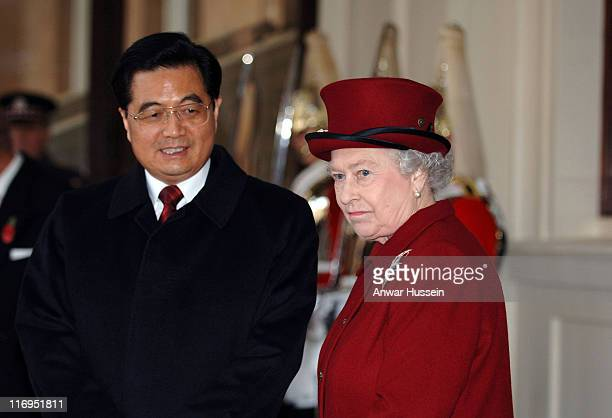Chinese President Hu Jintao and his wife Liu Yongqing accompanied by Queen Elizabeth ll and Prince Philip Duke of Edinburgh arrive at the grand...