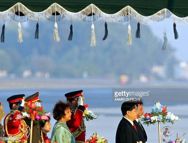 Chinese President Hu Jintao and his wife Liu Yongquing stand with Pakistani President Pervez Musharraf and his wife Sahiba Musharraf during a...
