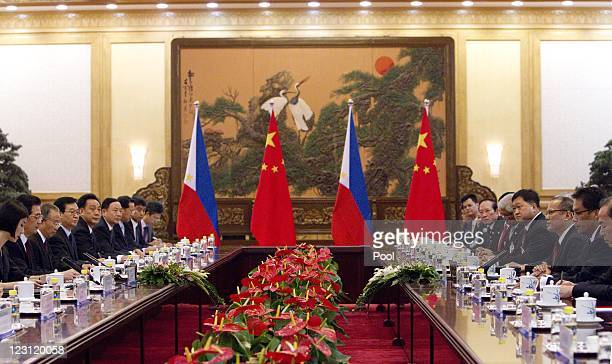 Chinese president Hu Jintao and Philippine president Benigno Aquino attend a meeting in the Great Hall of the People on 31 August 2011 in Beijing,...