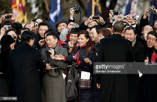 Chinese President Hu Jintao and U.S. President Barack Obama greet guests during a state arrival ceremony on the South Lawn of the White House January...