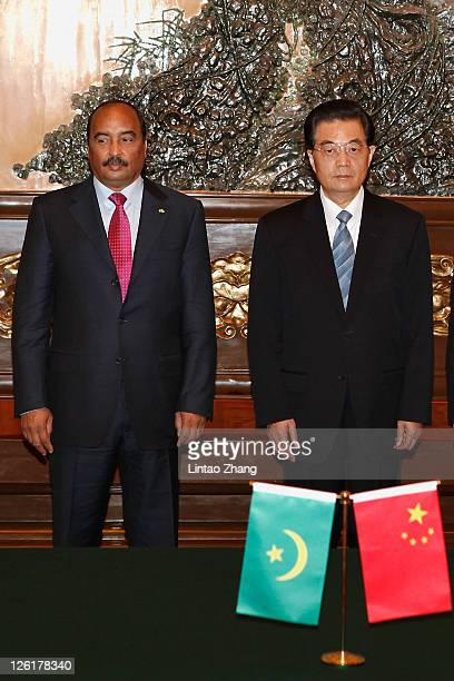 Chinese President Hu Jintao and visiting Mauritanian President Mohamed Ould Abdel Aziz attend a signing ceremony at the Great Hall of the People on...