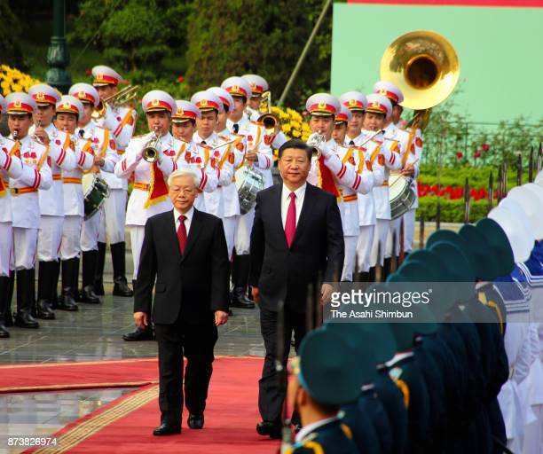 Chinese President Hu Jintao attends the welcome ceremony with General Secretary of the Communist Party of Vietnamese Nguyen Phu Trong on November 12...