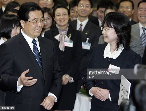 Chinese President Hu Jintao chats with Chinese student Zhang Zheng Yi, from a scholarship programme granted by Matsushita Electric Industrial Co,...