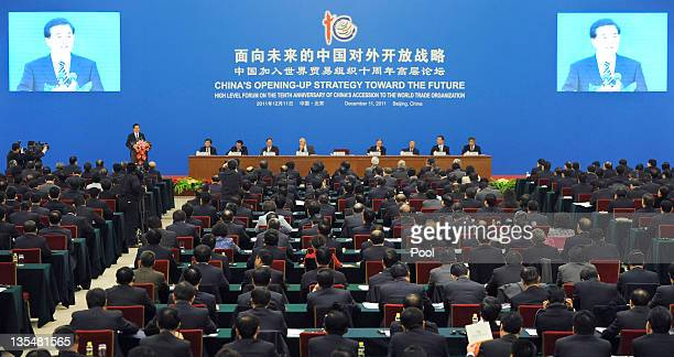 Chinese president Hu Jintao delivers his speech during the high level forum on the tenth anniversary of China's accession to the World Trade...
