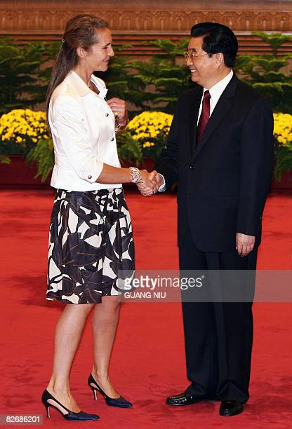 Chinese President Hu Jintao greets Spain's Princess Elena de Borbon prior to a welcome luncheon ahead of the opening ceremony of the 2008 Beijing...