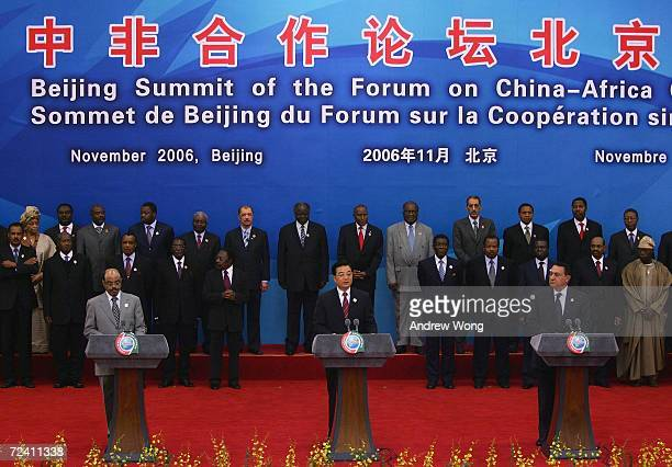 Chinese President Hu Jintao , his Egyptian counterpart Hosni Mubarak and Ethiopian Prime Minister Meles Zenawi read a joint declaration as the rest...