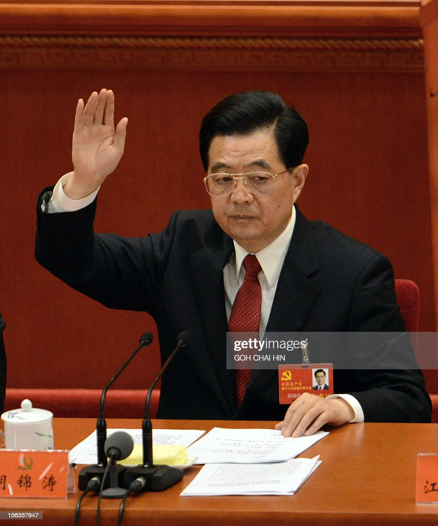 Chinese President Hu Jintao raises his hand to vote for the reports at the closing of the 18th Communist Party Congress at the Great Hall of the People in Beijing on 14 November 2012. The week-long Communist Party Congress will end with a transition of power to Chinese Vice President Xi Jinping, who will govern for the coming decade amid growing pressure for reform of the communist regime's iron-clad grip on power.