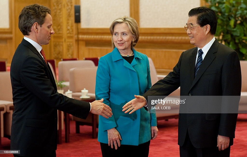Chinese President Hu Jintao reaches out to shake hands with US Treasury Secretary Timothy Geithner (L) alongside US Secretary of State Hillary Clinton (C) prior to meetings at the Great Hall of the People in Beijing on May 25, 2010. Clinton said two days of high-level Sino-US talks had been 'very productive' but admitted differences remained, especially on economic and trade issues. AFP PHOTO / POOL / Saul LOEB