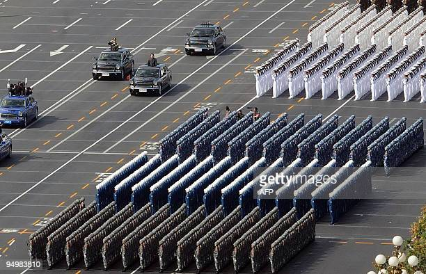Chinese President Hu Jintao reviews the military personnel during the National Day parade in Beijing on October 1 2009 China celebrated 60 years of...