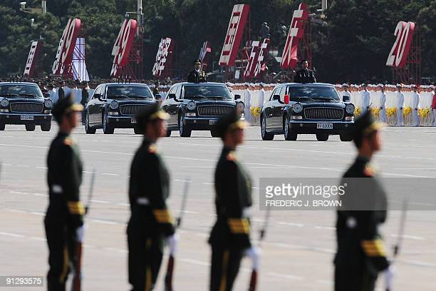 Chinese President Hu Jintao reviews the People's Liberation Army troops prior to the start of the National Day parade on Tiananmen Square in Beijing...