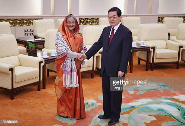 Chinese President Hu Jintao shakes hands with Premier of the People's Republic of Bangladesh Ms Sheikh Hasina inside the Great Hall of the People in...