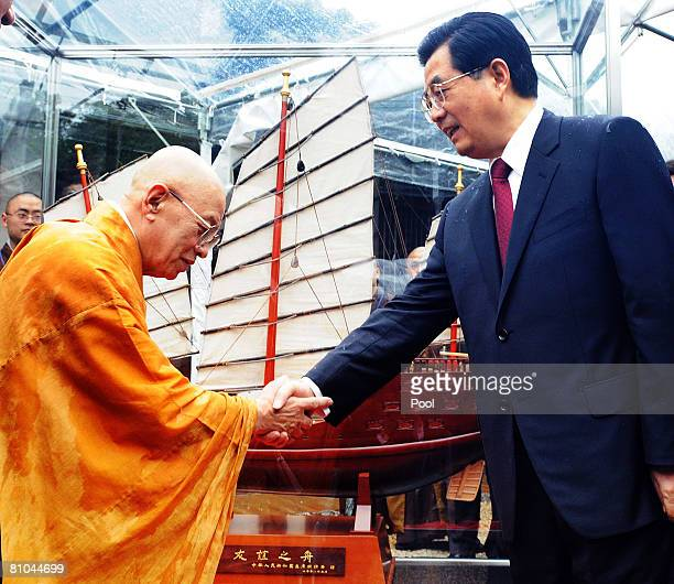 Chinese President Hu Jintao shakes hands with Toshodaiji Temple's chief priest Shunkai Matsuura at Mikage Do Hall in Toshodaiji Temple on May 10 2008...
