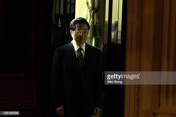 Chinese President Hu Jintao waits in the Green Room prior to the beginning of a joint press conference with U.S. President Barack Obama in the East...