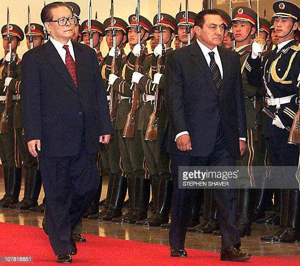 Chinese President Jiang Zemin and Eygptian President Hosni Mubarak inspect a military honor guard during a welcoming ceremony in Beijing 05 April...