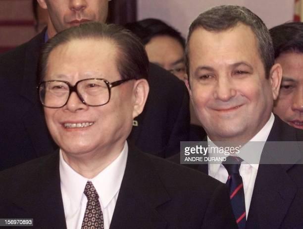 Chinese President Jiang Zemin and Israeli Prime Minister Ehud Barak depart after their press conference 13 April 2000 in Jerusalem. Barak hinted that...