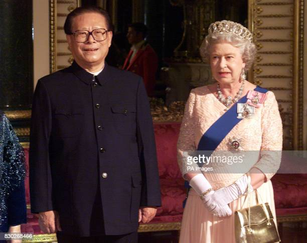 Chinese President Jiang Zemin and Queen Elizabeth II pose for a photograph in the Music Room prior to a state banquet at Buckingham Palace in London...