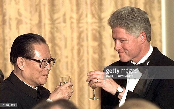 Chinese President Jiang Zemin and US President Bill Clinton share a toast during a state dinner 29 October in the East Room of the White House. Jiang...