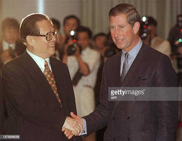 Chinese President Jiang Zemin greets Britain's Prince of Wales during a banquet and toast prior to handover ceremonies 30 June at the Hong Kong...