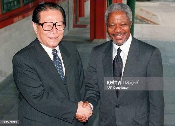 Chinese President Jiang Zemin greets visiting UN SecretaryGeneral Kofi Annan at Zhongnanhai the official compound of the Chinese leadership 08 May...