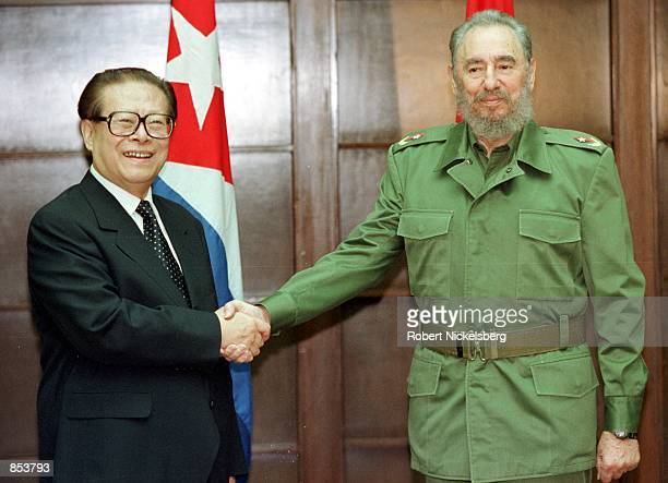 Chinese President Jiang Zemin is greeted by 74 year old Cuban President Fidel Castro April 13 2001 at the Council of State building in Havana Cuba...