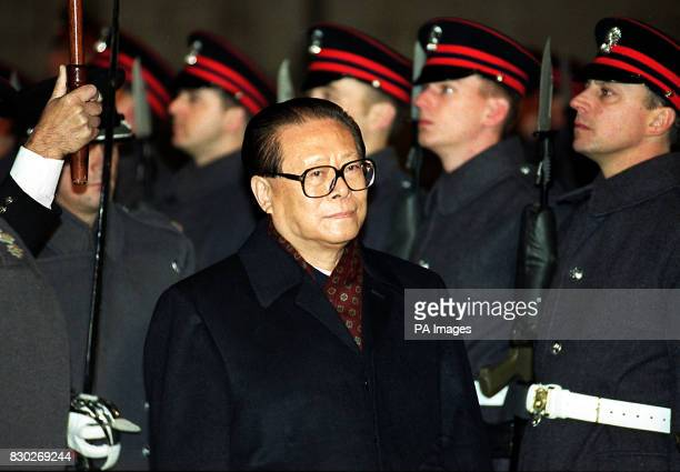 Chinese President Jiang Zemin reviews a guard of honour from the Honourable Artillery Company at London's Guildhall prior to a banquet in his honour...
