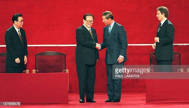 Chinese President Jiang Zemin shakes hands with Britain's Prince Charles following Hong Kong's transfer of sovereignty from British to Chinese rule...